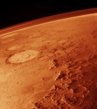 4 NASA.  Mars from low orbit, showing Galle_smiley_crater to the left.  1976.  Wikipedia.