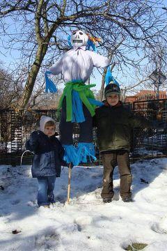 Marzanna effigy held by Polish children. Wikipedia.